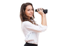 Looking for a carrier. Portrait of gorgeous young brunette holding powerful binoculars Royalty Free Stock Image
