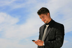 Looking at the cell phone Stock Photo
