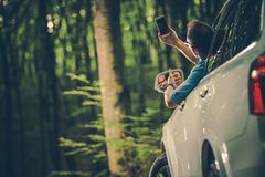 Looking For Cellphone Signal. Caucasian Men in His 30s Looking For Cellphone Signal From Inside His Car Stock Images