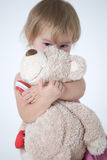 Looking of the child. Little girl is huging the bear toy and looking Royalty Free Stock Photo