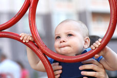 Looking child at playground Stock Photo