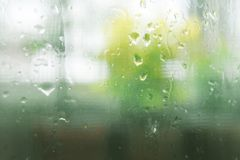 Looking through the clear glass to the outside while it rain. Stock Photography