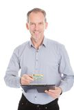 Looking at clipboard through magnifying glass Royalty Free Stock Image