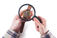 Looking at clock through loupe 2. Man hold loupe and look through it on a clock Royalty Free Stock Photos