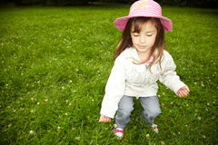 Looking for a cloverleaf. Young girl searching for a four leaved clover Royalty Free Stock Photography