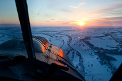 Looking from cockpit of old airplane during winter sunrise Stock Photo