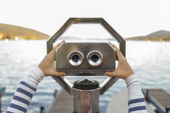 Looking through coin operated binoculars Royalty Free Stock Photography