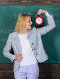 Looking committed teacher complement qualified workforce educators. School discipline concept. Woman teacher hold alarm. Clock. She cares about discipline. Time stock photography