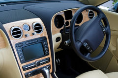 Looking in at convertible car dashboard. Looking in at expensive convertible car dashboard royalty free stock photo