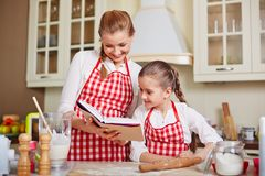 Looking at cookery book Royalty Free Stock Images