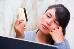 Looking at credit card Stock Photo