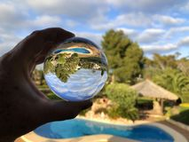 Creative photography, crystal ball refraction. royalty free stock photo