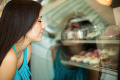 Looking at cupcakes through glass Stock Photos