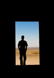 Looking Into the Desert. Standing at the door, taking a look into the desert Stock Photos