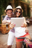 Looking at digital map on tablet Stock Photo