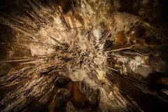 Looking directly up at Stalactite in cave Stock Photography