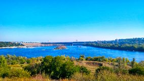 Dnipro hydroelectric power station and Dnipro river. Looking at the Dnipro hydroelectric power station from the island of Khortytsia Royalty Free Stock Photography