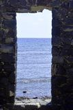 Looking through doors to wards blue sea.Canary Islands. Spain. Royalty Free Stock Photography