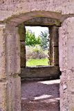 Bancroft Castle, Town of Groton, Middlesex County, Massachusetts, United States. Looking through doorway and window of Bancroft tower.  Bancroft Castle, atop Royalty Free Stock Photos