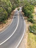 Looking down on asphalt road Stock Images