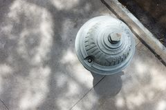 Urban city fire hydrant top view looking down royalty free stock photography