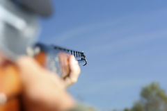 Looking Down the Barrel. Extreme depth of field. Man aiming a shotgun. Camera angle looking down the barrel with only the sights in focus Royalty Free Stock Photos