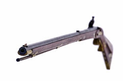 Looking down the barrel of a black powder rifle. Black powder flint lock rifle with the focus on the muzzle end of the gun Stock Image