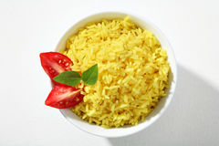 Looking down at a bowl of yellow rice dish Stock Images