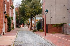 Looking down a brick street in Philadelphia Pennsylvania. On a rainy summer day Royalty Free Stock Image