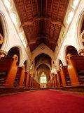Looking down the centre aisle of an Old church cathedral stock image