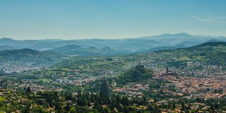 Looking down on the city of Le Puy en Velay. Le Puy-en-Velay, the capital of the department Haute-Loire in the Auvergne, France. Looking down on the city you see royalty free stock images