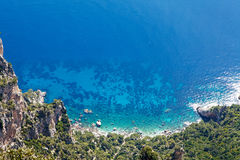 Looking Down Cliff onto Mediterranean Sea Royalty Free Stock Image