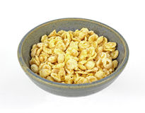 Looking Down Coated Flake Cereal. Looking down at a tempting bowl of dry cereal Royalty Free Stock Images