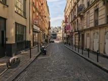 Looking down cobbled street in Pigalle neighborhood of Paris Royalty Free Stock Photo