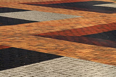 Looking down on colourful brick paving. Looking down on outdoor colourful brick paving royalty free stock photo