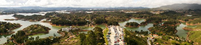 Looking down from el penon de Guatape near medellin, Colombia. Panoramic View royalty free stock images