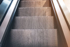 Looking down on escalator. Steps of escalator closeup - looking down Stock Photo