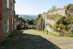 Gold Hill Shaftesbury - Dorset. Looking down the famous cobbled Gold Hill in Shaftesbury Dorset, England stock image