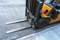 Close up of fork lift blades on an urban city street royalty free stock image