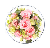 Looking down into a glass bowl full of pink roses stock photo