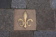 Fleur de lys in a tile Royalty Free Stock Photos