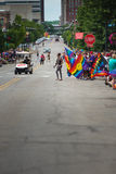 Looking down Locust Street during Gay Pride Parade. Taken in Des Moines, Iowa. The streets begin to gather and participants hold rainbow flags in support for stock image