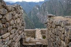Looking Down From Machu Picchu. The view from the ruins of Machu Picchu, Peru royalty free stock image