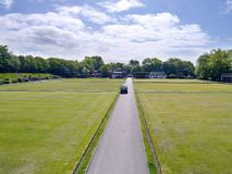 Well kept lawns for bowling. Looking down main pathway between well kept lawn areas for bowling etc stock photos