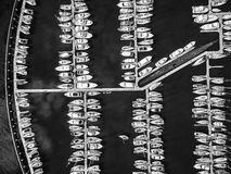 Looking down at moored boats in black and white Stock Photo