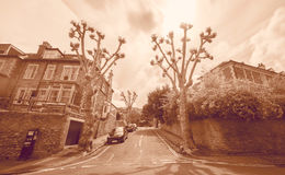 Looking Down Narrow Street in Redland Bristol England. Long Exposure Photography Motion Blur Sepia Tone Stock Photos