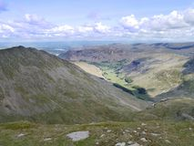 Looking down from Nethermost Pike summit to Grisedale valley Royalty Free Stock Photo