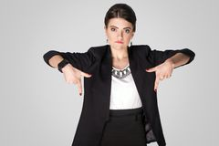 Looking down now! Seriously woman pointing finger down royalty free stock photo