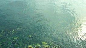 Looking down at ocean bay shore stock video footage