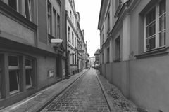 Looking Down Orphan Street in Poznan. Poland; PL Ulica Sieroca, Black and White Photography Stock Image